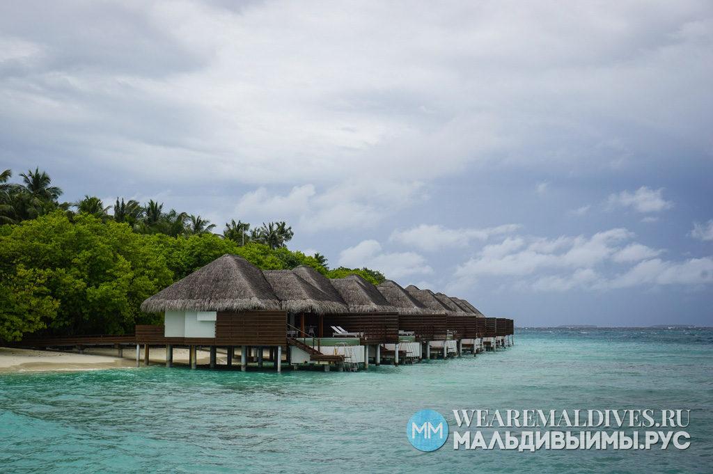 Водные виллы на пляже в острове отеле Dusit Thani Maldives